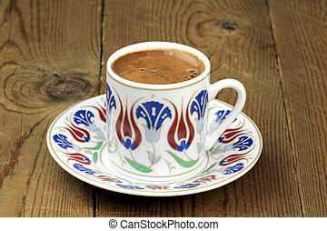 Turkish coffee with traditional ottomans motif cup close up...