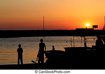 Silhouette of children in sunset at beach