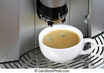 Espresso machine and a cup of coffee close up image