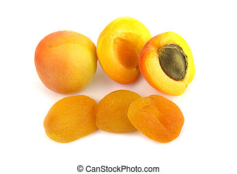 Fresh and sun dried apricots on white background