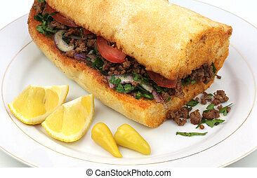 Traditional Turkish cuisine, Tantuni with loaf bread close...