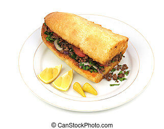 Traditional Turkish cuisine, Tantuni with loaf bread on...