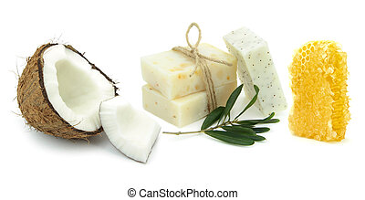 Natural herbal soaps with coconut, olive and honey on white...