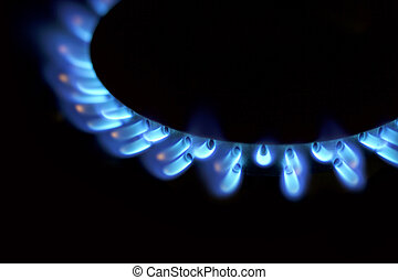 Natural gas blue flames on black background