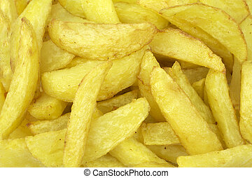 Delicious fried potatoes close up image