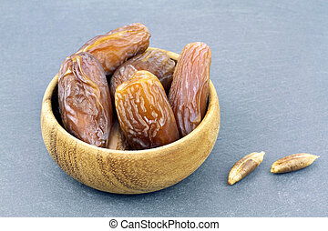 Yummy date fruits on grey background
