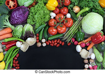Fresh colorful vegetables with black text space close up...