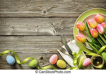 Easter table setting with spring tulips and cutlery....