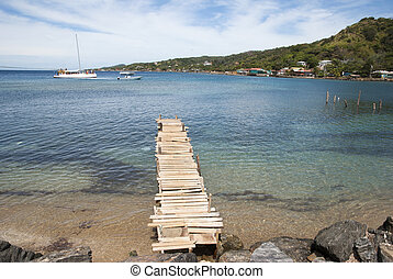 Roatan Island Bay - The view of wooden pier in Coxen Hole...
