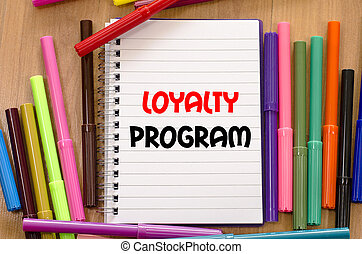 Loyalty program text concept - Felt-tip pen and notepad on a...