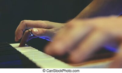 Playing piano. Close Up view. Two hands playing the pianoin...