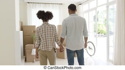 Loving young couple saying goodbye to their home as they...