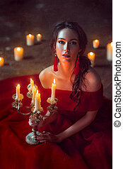 Beautiful lady with candles - Beautiful lady dressed in red...