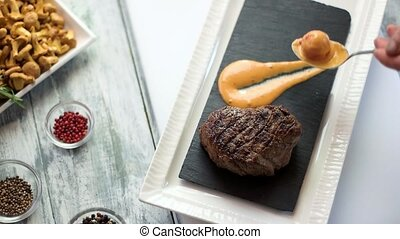Grilled steak and cognac sauce. Spoon with cherry tomato....