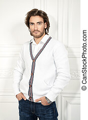 man in white cardigan - Attractive young man wearing white...