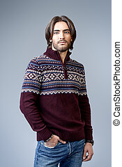 pullover with ornament - Handsome man wearing winter...