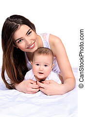 favorite baby - Happy young mother tenderly embracing her...