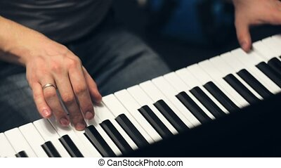 Playing piano. Top view. Two hands playing the piano