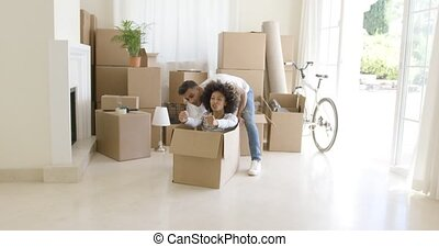 Fun young woman inside a packing box - Fun young African...
