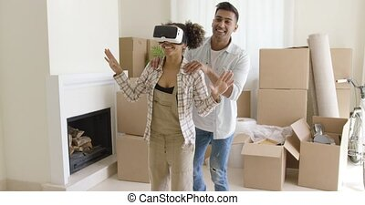 Happy young couple doing Virtual tour in new apartment -...