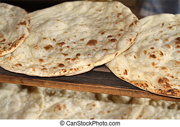 Fresh baked tandoori flatbread close up image