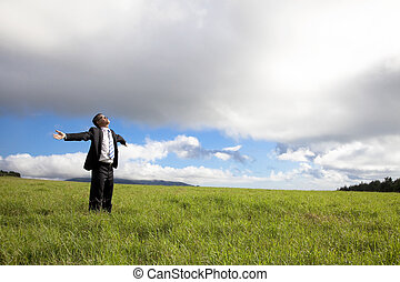 happy and Relaxation businessman standing on the green field...