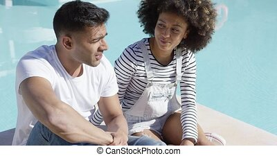 Attractive African couple chatting in the sun - Attractive...