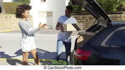 Young African American couple moving home working as a team...