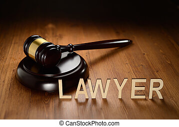 Lawyer wooden letters - Gavel and Lawyer word written with...
