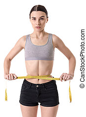 Very skinny girl - Suffering from anorexia. Girl measuring...