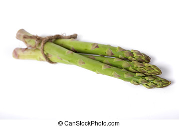 Raw asparagus isolated on white