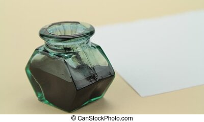 Ink bottle, quill pen and parchment
