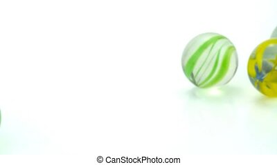 Rolling glass marbles 1920 x 1080p HD video