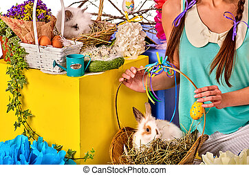 Cropped shot of woman in easter style holding bunny...