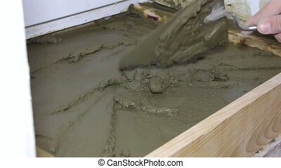 Plasterer working with cement and trowel - Plasterer builder...