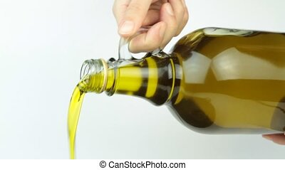 Pouring extra virgin olive oil from glass bottle 1920 x...
