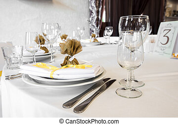 serving wedding table. on the table is a plate, knife, wine...