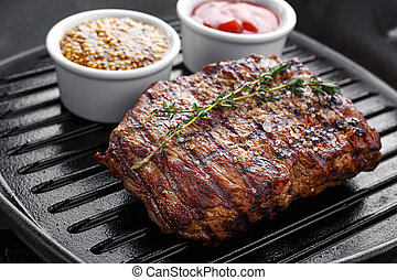 cooked steak on grill pan - cooked steak on the grill pan on...