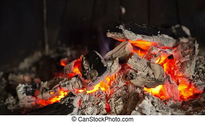 incandescent embers with ash in fireplace - incandescent...
