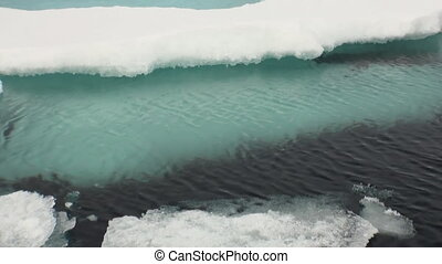 Clear cold blue water, ice in Arctic Ocean.
