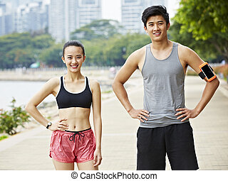 outdoor portrait of asian exercising man and woman