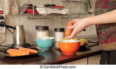 Cleaning boiled carrot in the kitchen