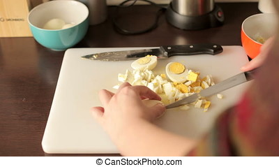 Cleaning boiled potatoes for dinner preparation