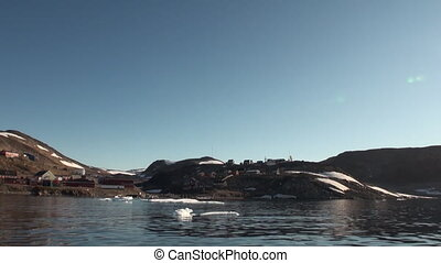 Township in mountains on the shores of of Greenland Arctic...