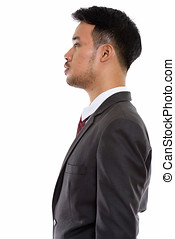 Profile view of young Asian businessman