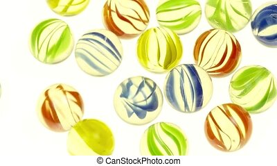 Rolling glass marbles