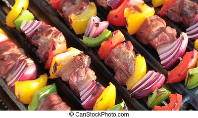 Barbecue. Shish kebab with grilled peppers and onion, on hot...
