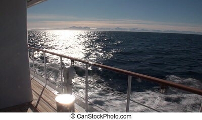Mountains on the background of waves. View from the ship.