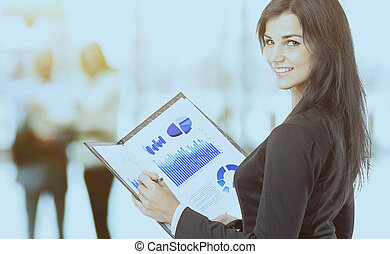 Business woman with charts and diagrams