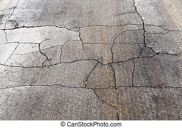 very bad road - a very bad crumbling asphalt road with holes...